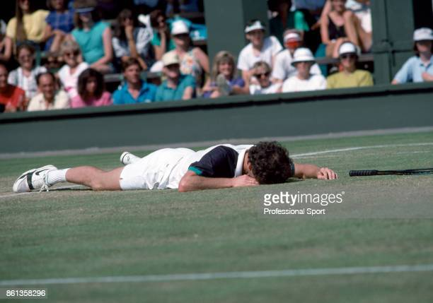 John McEnroe of the USA after falling during the Wimbledon Lawn Tennis Championships at the All England Lawn Tennis and Croquet Club circa June 1989...