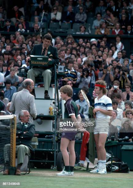 John McEnroe of the USA argues with the tournament referee Fred Hoyles on Centre Court during the Wimbledon Lawn Tennis Championships at the All...