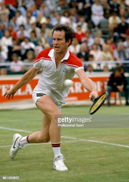 John McEnroe of the USA in action during the Stella Artois Championships at the Queen's Club in London England circa June 1982
