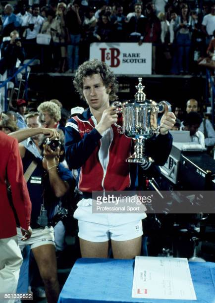 John McEnroe of the USA lifts the trophy after defeating Vitas Gerulaitis of the USA to win the US Open at the USTA National Tennis Center on...
