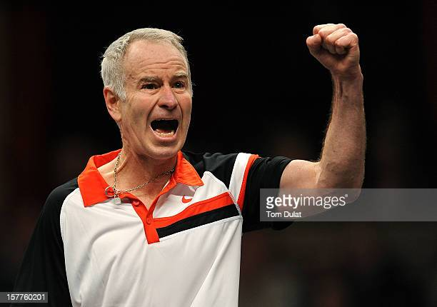 John McEnroe of United States celebrates during match against Jeremy Bates of Great Britain on Day Two of the Statoil Masters Tennis at the Royal...