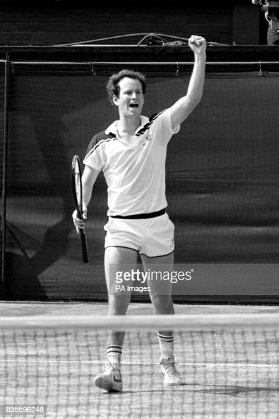 John McEnroe pumps his fist in celebration after winning Wimbledon