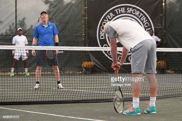 John McEnroe reacts after missing a ball while Jim Courier looks during an exhibition match between John McEnroe and Jim Courier at Casa de Campo...