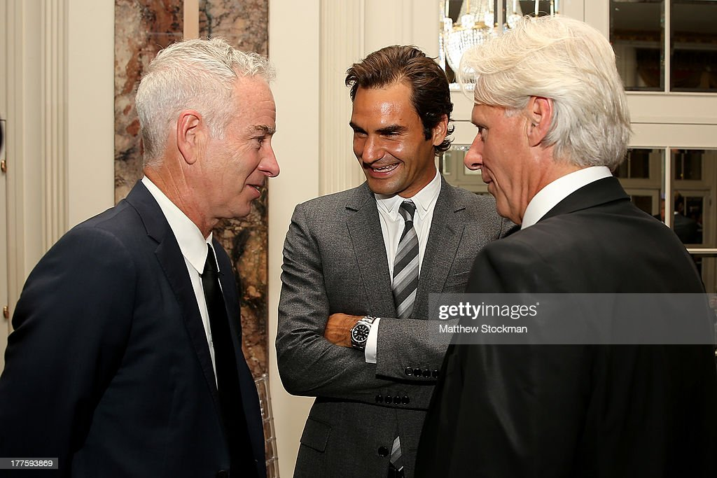 John McEnroe; Roger Federer of Switzerland and Bjorn Boreg of Sweden wait to go on stage before the ATP Heritage Celebration at The Waldorf=Astoria on August 23, 2013 in New York City.