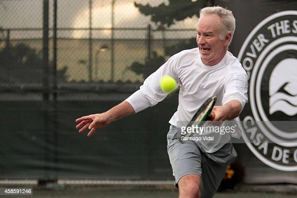 John McEnroe runs to hit the ball during an exhibition match between John McEnroe and Jim Courier at Casa de Campo Hotel on November 07 2014 in La...