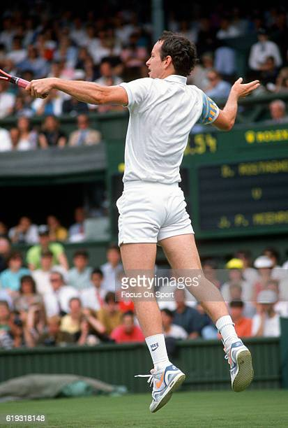 John McEnroe serves during a men's hits a return match at the Wimbledon Lawn Tennis Championships circa 1993 at the All England Lawn Tennis and...
