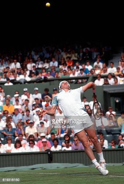 John McEnroe serves during a men's singles match at the Wimbledon Lawn Tennis Championships circa 1993 at the All England Lawn Tennis and Croquet...