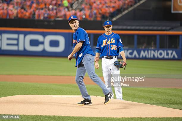 John McEnroe throws the first pitch at the New York Mets vs New York Yankees baseball game at Citifield