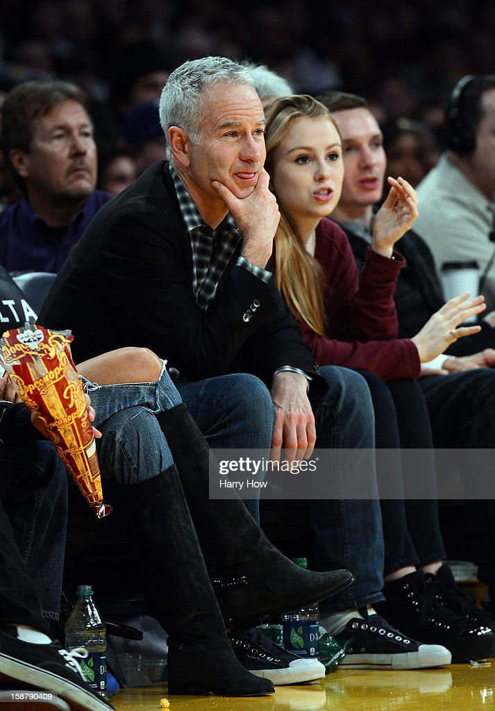 John McEnroe watches the game between the Portland Trail Blazers and the Los Angeles Lakers at Staples Center on December 28, 2012 in Los Angeles, California.