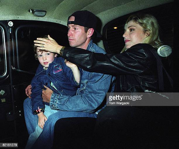 John McEnroe with wife Tatum O'Neal and son Kevin at Hard Rock Cafe on June 20 1992 in London England