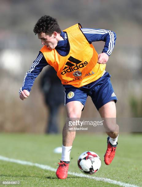 John McGinn controls the ball during a training session at Mar Hall on March 23 2017 in Erskine Scotland