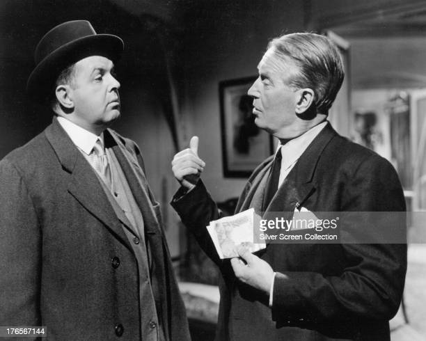 John McGiver as Monsieur X and Maurice Chevalier as Claude Chavasse in 'Love In The Afternoon' directed by Billy Wilder 1957