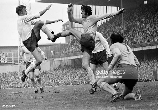 John McGovern of Derby County challenging Tottenham Hotspur defender Mike England with Alan Gilzean looking on during their match at the Baseball...