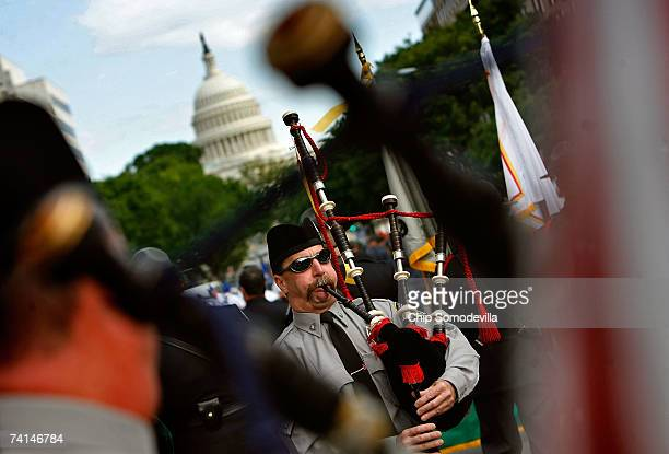 John McGrady a fire Captain from Kearny New Jersey joins hundreds of law enforcement bagpipe players and honor guards for the Twelfth Annual Emerald...