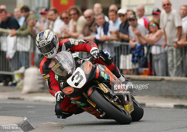 John McGuinness in action during the senior race in the Isle of Man TT Races on June 8 2007 in Isle of Man