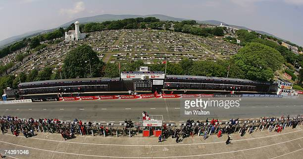 John McGuinness passes the Grand stand during the Bennetts Superbike race at the Isle of Man TT Races on Jun 4 2007 in Isle of Man