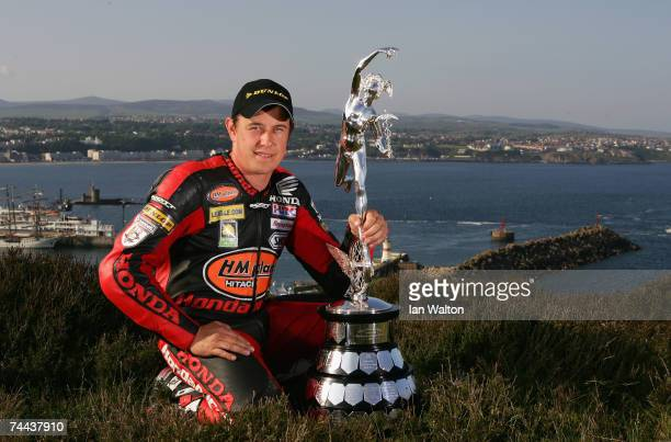 John McGuinness poses with the senior trophy during the Isle of Man TT Races on June 7 2007 in Douglas Isle of Man