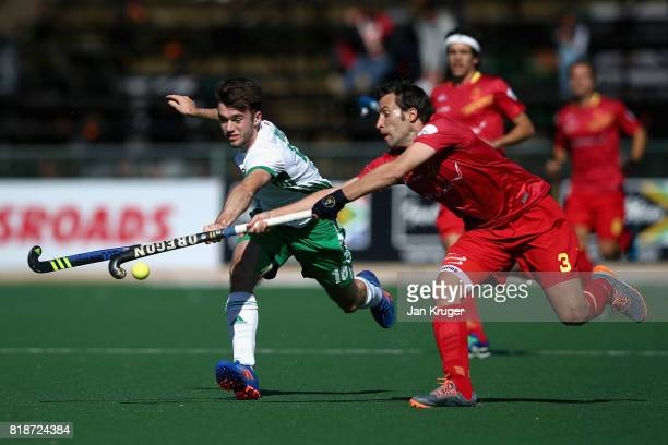 John McKee of Ireland and Sergi Enrique of Spain battle for possession during the Quarter final match between Spain and Ireland during Day 6 of the...