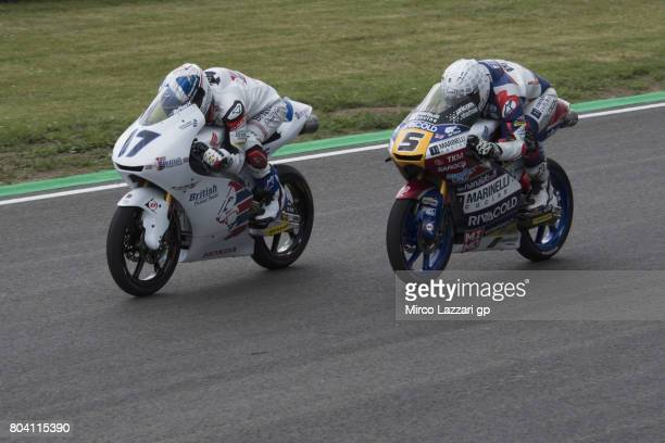 John McPhee of Great Britain and British Talent Team leads Romano Fenati of Italy and Marinelli Rivacold Snipers Team during the MotoGp of Germany...