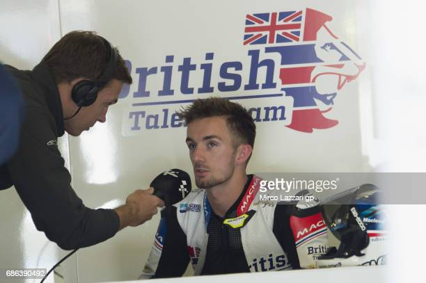 John McPhee of Great Britain and British Talent Team speaks with journalist in box after the forced stopped of the race during the Moto3 race during...