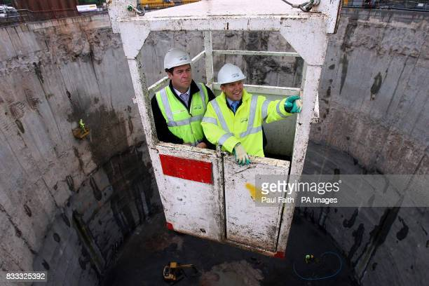 John McReynolds Deputy project Manager with Morgan Farrans and Bill Cowdy from Northern Ireland Water are lowered into the largest excavation in the...