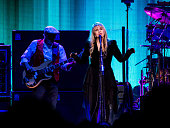 John McVie and Stevie Nicks of Fleetwood Mac perform during the On With the Show Tour 2014 at The Palace of Auburn Hills on October 22 2014 in Auburn...