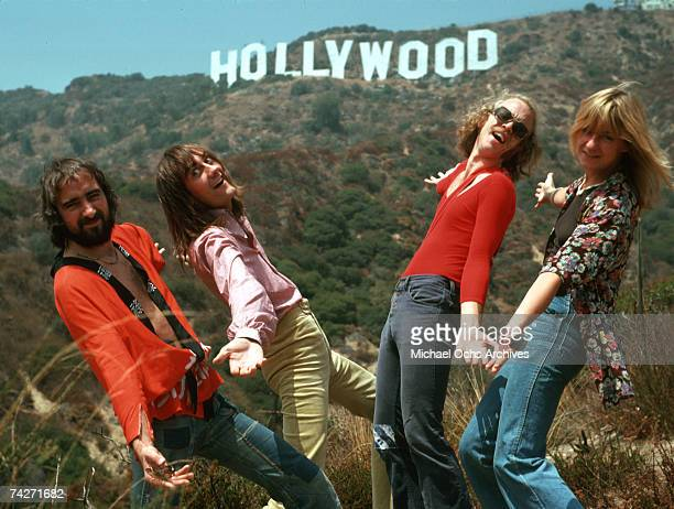 John McVie Mick Fleetwood Bob Welch and Christine McVie of the rock group 'Fleetwood Mac' pose for a portrait under the Hollywood Sign in August 1974...
