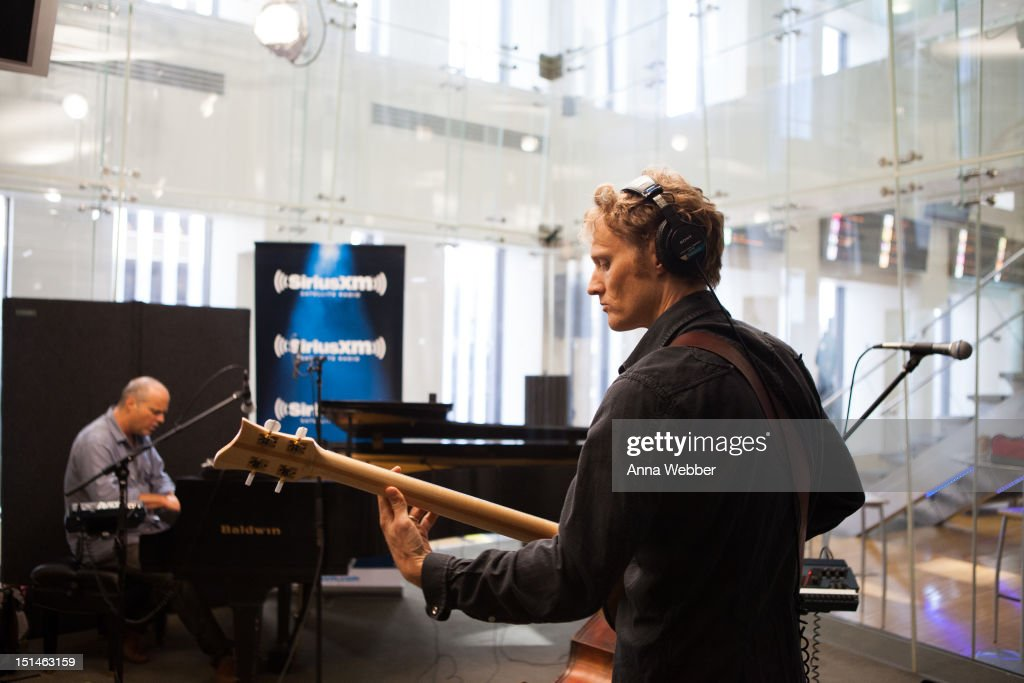 John Medeski and Chris Wood of Medeski, Martin & Wood performs during Medeski, Martin & Wood on SiriusXM's Jam_On and Real Jazz channels in the SiriusXM studios on September 7, 2012 in New York City.