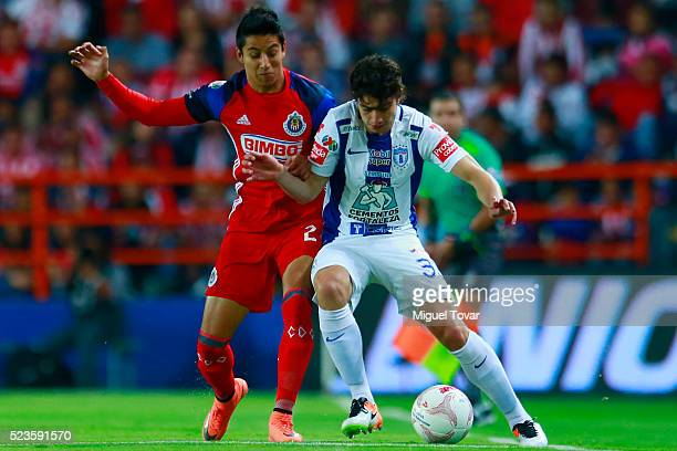 John Medina of Pachuca fights for the ball with Carlos Cisneros of Chivas during the 15th round match between Pachuca and Chivas as part of the...