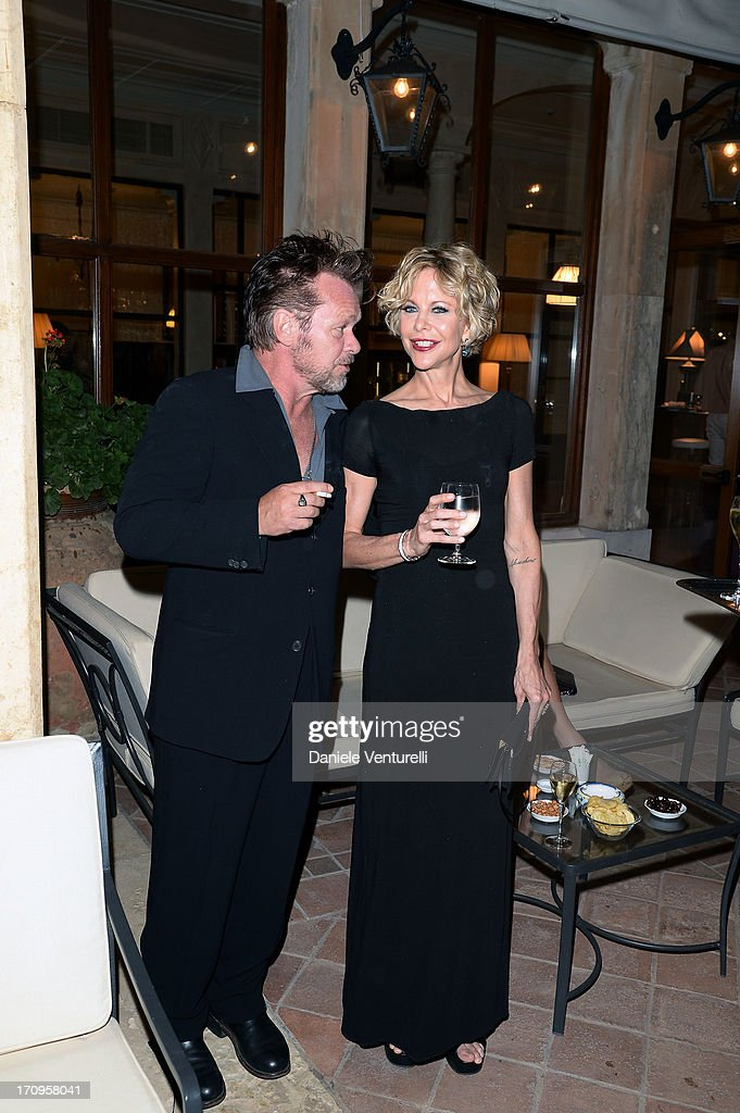 John Mellencamp and Meg Ryan attend Taormina Filmfest 2013 2013 at Teatro Antico on June 20, 2013 in Taormina, Italy.