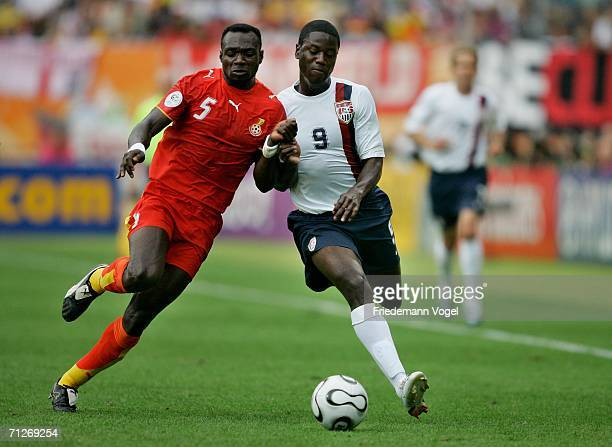 John Mensah of Ghana and Eddie Johnson of USA battle for the ball during the FIFA World Cup Germany 2006 match between Ghana and USA played at the...