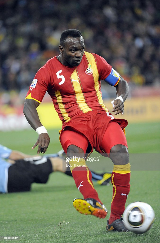 <a gi-track='captionPersonalityLinkClicked' href=/galleries/search?phrase=John+Mensah&family=editorial&specificpeople=548020 ng-click='$event.stopPropagation()'>John Mensah</a> of Ghana in action during the 2010 FIFA World Cup South Africa Quarter Final match between Uruguay and Ghana at the Soccer City stadium on July 2, 2010 in Johannesburg, South Africa. The match ended 1-1 after extra-time. Uruguay won 4-2 on penalties.