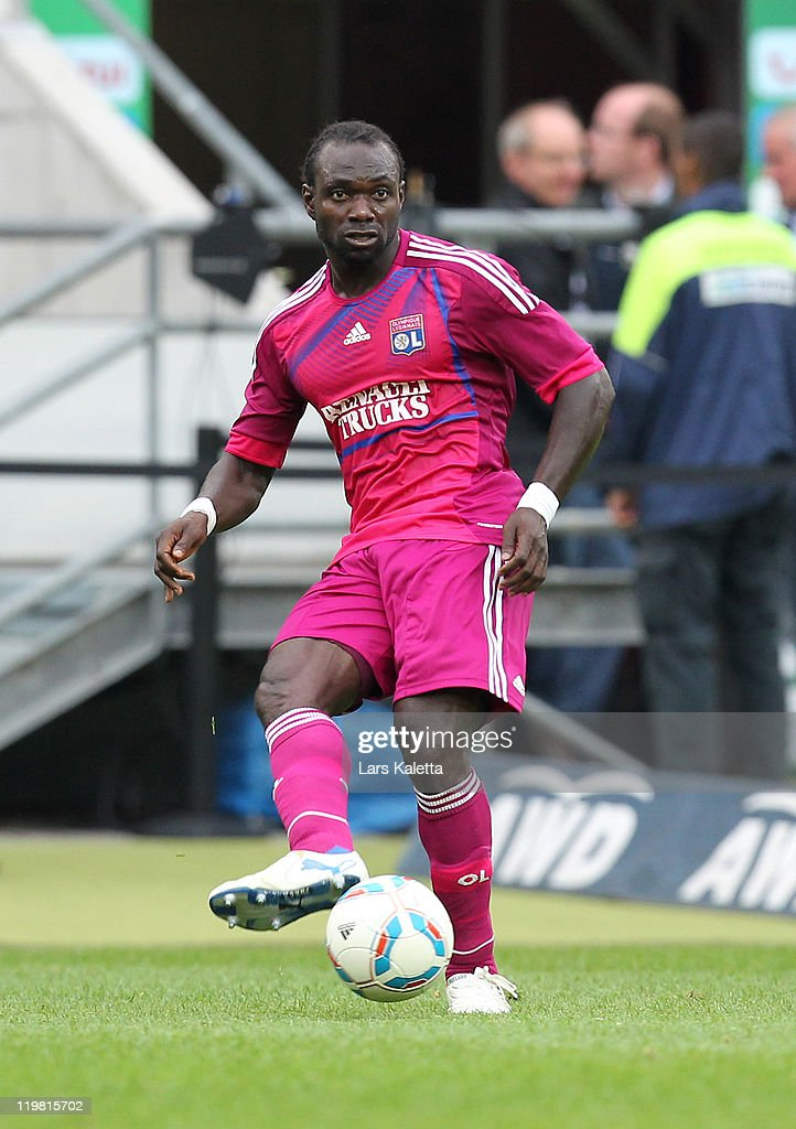<a gi-track='captionPersonalityLinkClicked' href=/galleries/search?phrase=John+Mensah&family=editorial&specificpeople=548020 ng-click='$event.stopPropagation()'>John Mensah</a> of Lyon runs with the ball during the pre season friendly match between Hannover 96 and Olympique Lyon at the AWD Arena on July 24, 2011 in Hannover, Germany.