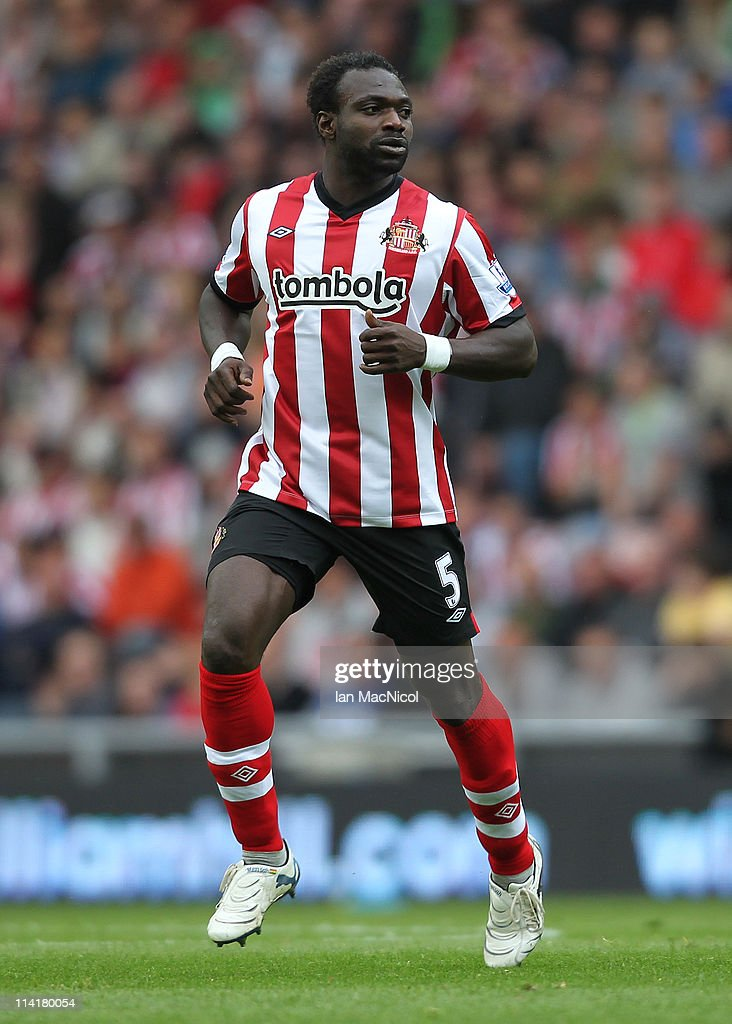 <a gi-track='captionPersonalityLinkClicked' href=/galleries/search?phrase=John+Mensah&family=editorial&specificpeople=548020 ng-click='$event.stopPropagation()'>John Mensah</a> of Sunderland during the Barclays Premier League match between Sunderland and Wolverhampton Wanderers at The Stadium of Light on May 14, 2011 in Sunderland, England.