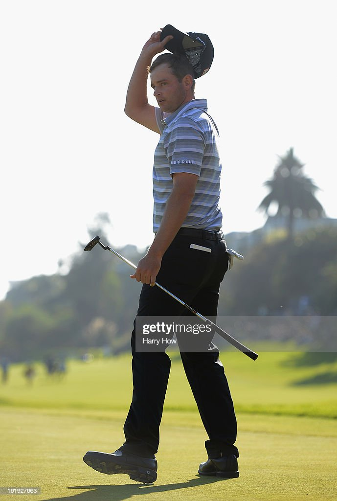 John Merrick celebrates his par putt to force a playoff during the final round of the Northern Trust Open at the Riviera Country Club on February 17, 2013 in Pacific Palisades, California. Merrick would beat Charlie Beljan on the second playoff hole to win the tournament.