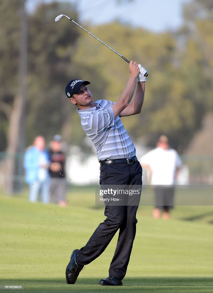 John Merrick hits a second shot on the second playoff hole during the final round of the Northern Trust Open at the Riviera Country Club on February 17, 2013 in Pacific Palisades, California. Merrick would beat Charlie Beljan on the second playoff hole to win the tournament.