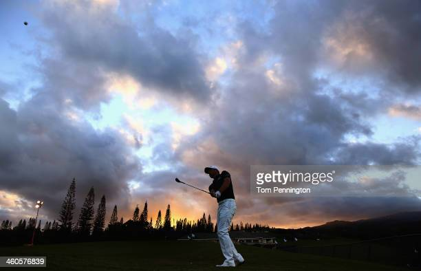 John Merrick hits a shot on the practice green before the start of round two of the Hyundai Tournament of Champions at the Plantation Course at...
