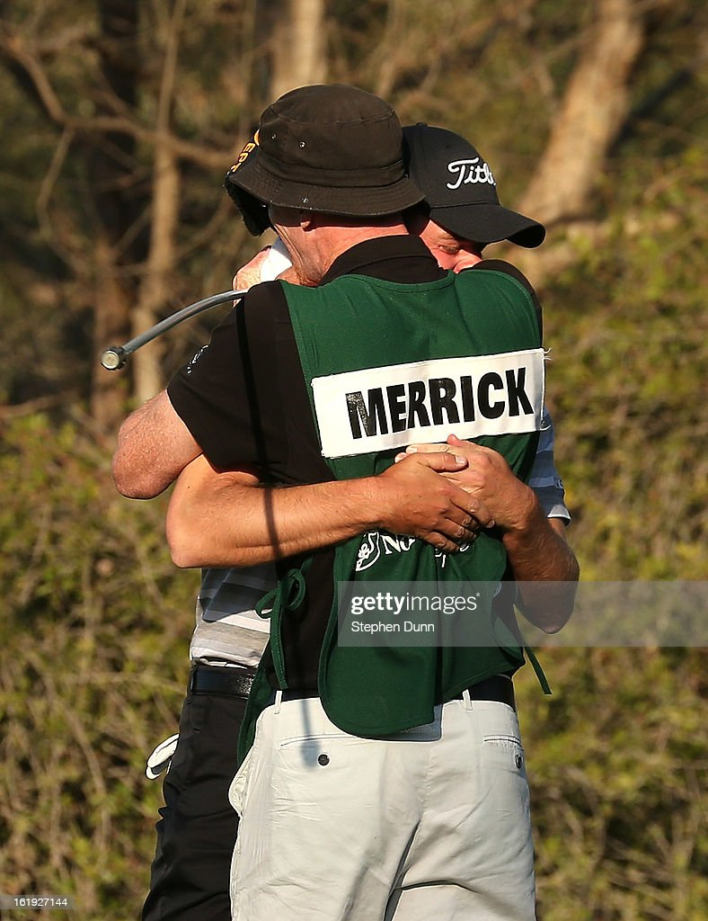 John Merrick hugs his caddie Ryan Goble after winning on the second playoff hole during the final round of the Northern Trust Open at Riviera Country Club on February 17, 2013 in Pacific Palisades, California.