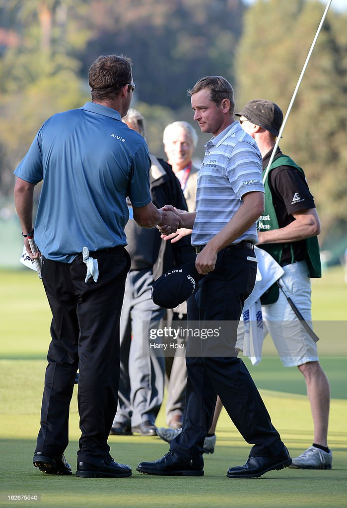 John Merrick receives a handshake from Charlie Beljan for his win on the second playoff hole during the final round of the Northern Trust Open at the Riviera Country Club on February 17, 2013 in Pacific Palisades, California.