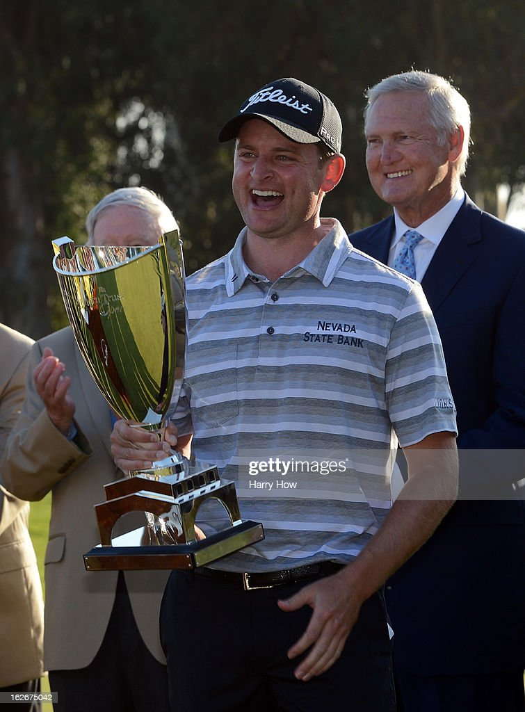 John Merrick smiles with the trophy after his playoff win over Charlie Beljan on the second playoff hole during the final round of the Northern Trust Open at the Riviera Country Club on February 17, 2013 in Pacific Palisades, California.