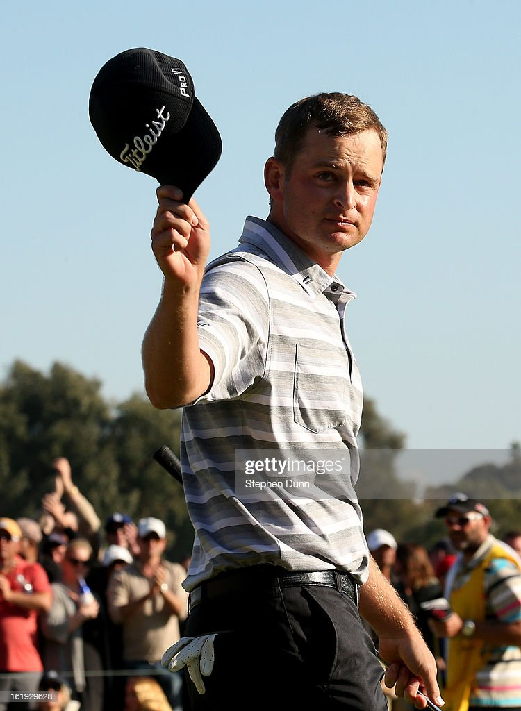 John Merrick tips his hat to the crowd after putting out in regulation during the final round of the Northern Trust Open at Riviera Country Club on February 17, 2013 in Pacific Palisades, California.