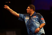 John Michael of Greece in action during his first round match against Ian White of England on day four of the 2015 William Hill PDC World Darts...