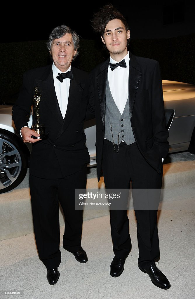John Midgley (L) and a guest arrive at Audi Arrivals at 20th annual Elton John AIDS Foundation Academy Awards viewing party on February 26, 2012 in Beverly Hills, California.