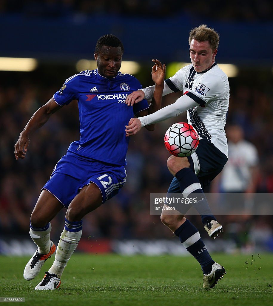 John Mikel Obi of Chelsea and Christian Eriksen of Tottenham Hotspur battle for the ball during the Barclays Premier League match between Chelsea and Tottenham Hotspur at Stamford Bridge on May 02, 2016 in London, England.