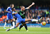 John Mikel Obi of Chelsea and Marko Arnautovic of Stoke City compete for the ball during the Barclays Premier League match between Chelsea and Stoke...