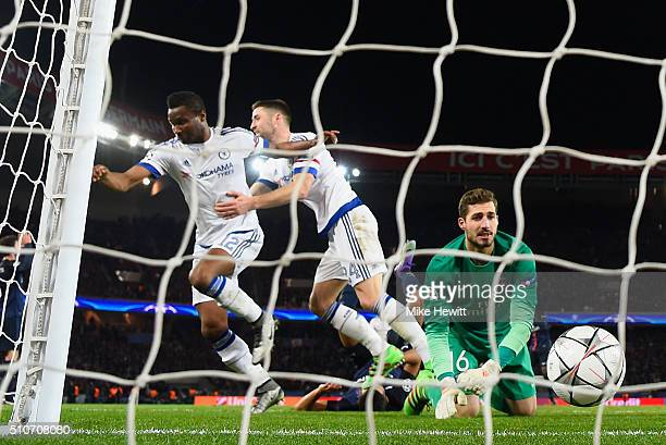 John Mikel Obi of Chelsea celebrates with Gary Cahill as he scores their first and equalising goal past goalkeeper Kevin Trapp of Paris SaintGermain...