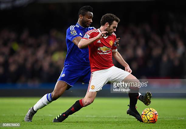 John Mikel Obi of Chelsea tackles Juan Mata of Manchester United during the Barclays Premier League match between Chelsea and Manchester United at...