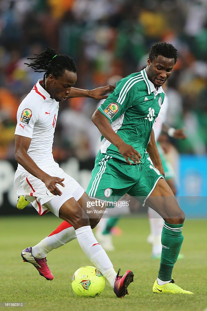 John Mikel Obi of Nigeria tries to tackle Bakary Kone of Burkina Faso during the 2013 Africa Cup of Nations Final match between Nigeria and Burkina at FNB Stadium on February 10, 2013 in Johannesburg, South Africa.
