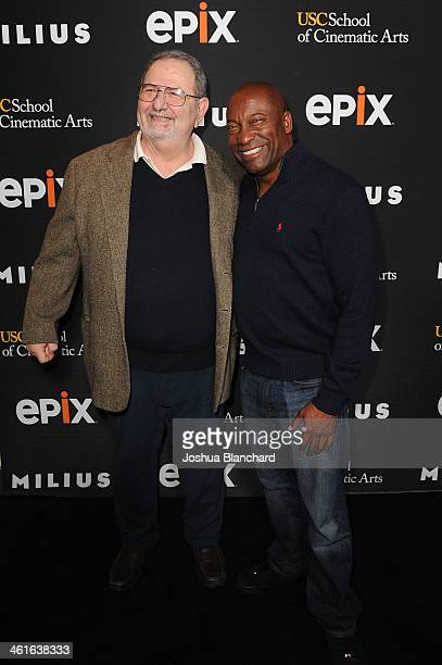 John Milius and John Singleton arrive at EPIX USC Host An Evening With John Milius at USC Norris Theatre on January 9 2014 in Los Angeles California