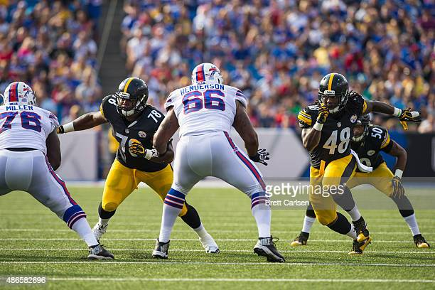 John Miller and Seantrel Henderson of the Buffalo Bills tries to stop LT Walton Bud Dupree of the Pittsburgh Steelers during a preseason game on...